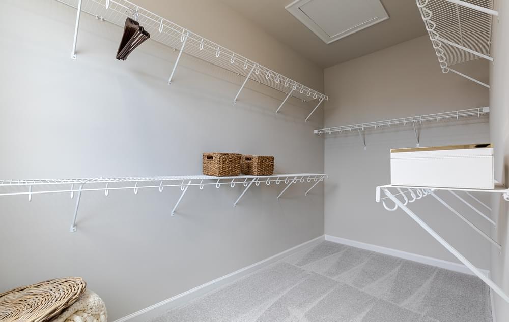 Graham Home Design Owner's Walk In Closet. New Home in Suwanee, GA