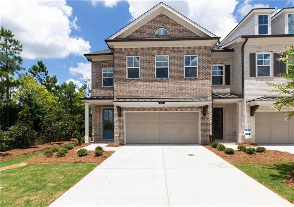 Pictures not of Actual Home But of a previously built Stockton plan - This hone is under construction . Suwanee, GA New Home