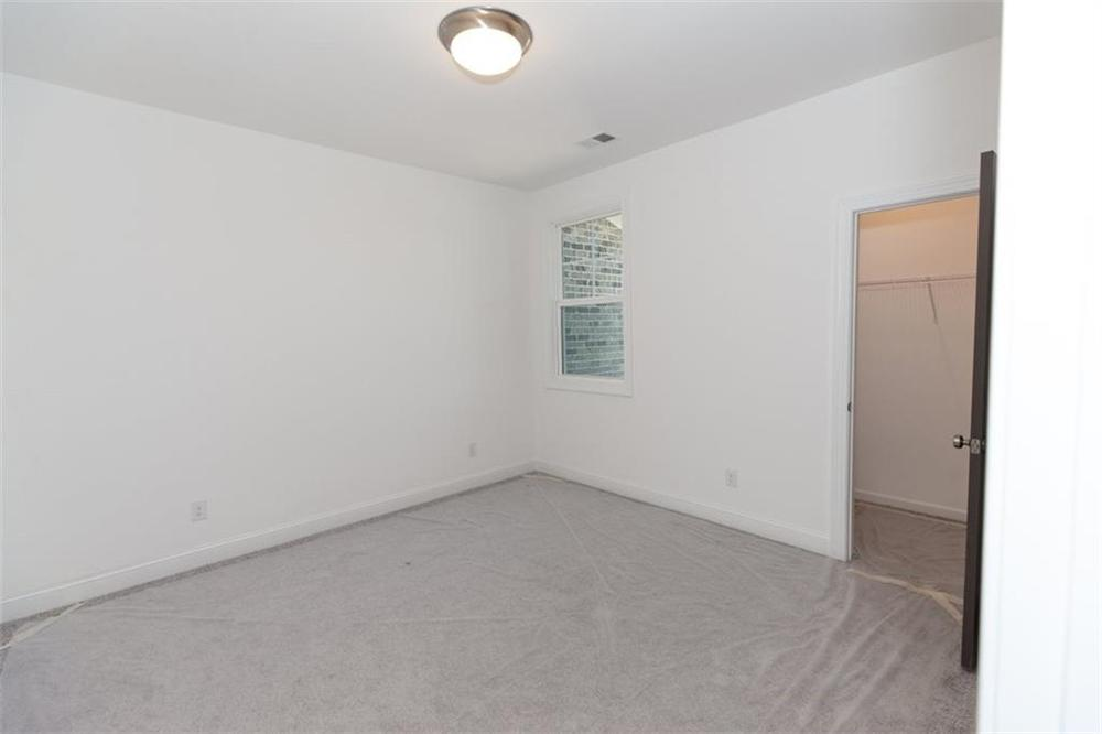 Secondary Bedroom . 3br New Home in Duluth, GA