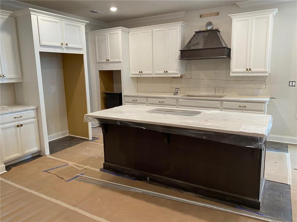 Kitchen w/Whirlpool appliances and wood hood. 2,960sf New Home in Alpharetta, GA