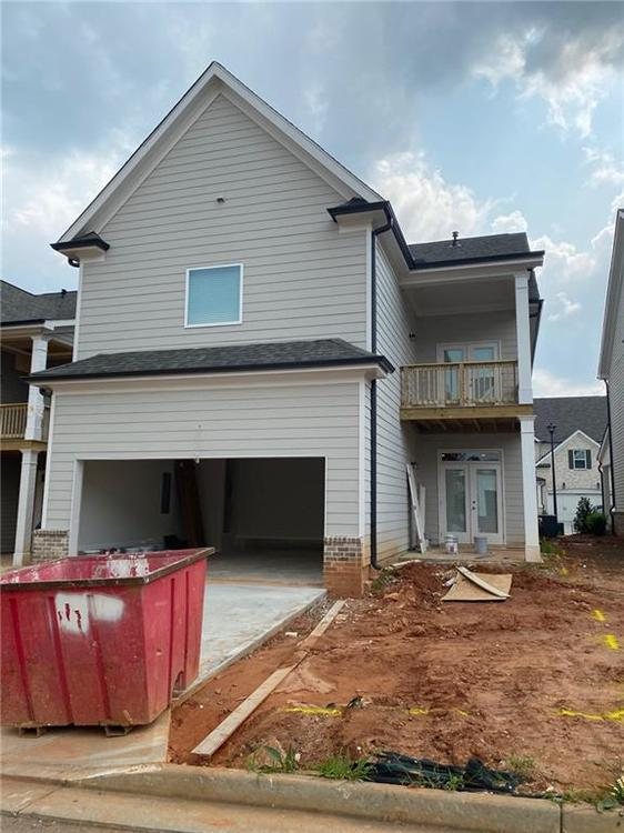 Rear view of home and garage as well as two covered porches. New Home in Alpharetta, GA