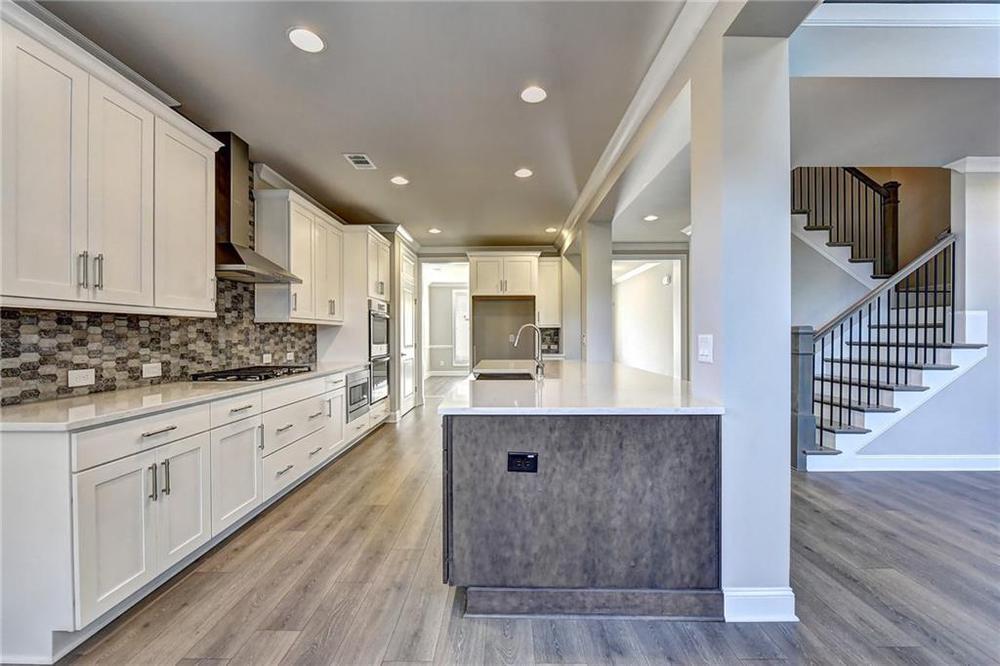 Not actual home. Photo of previously built Calhoun floorplan. 5br New Home in Alpharetta, GA