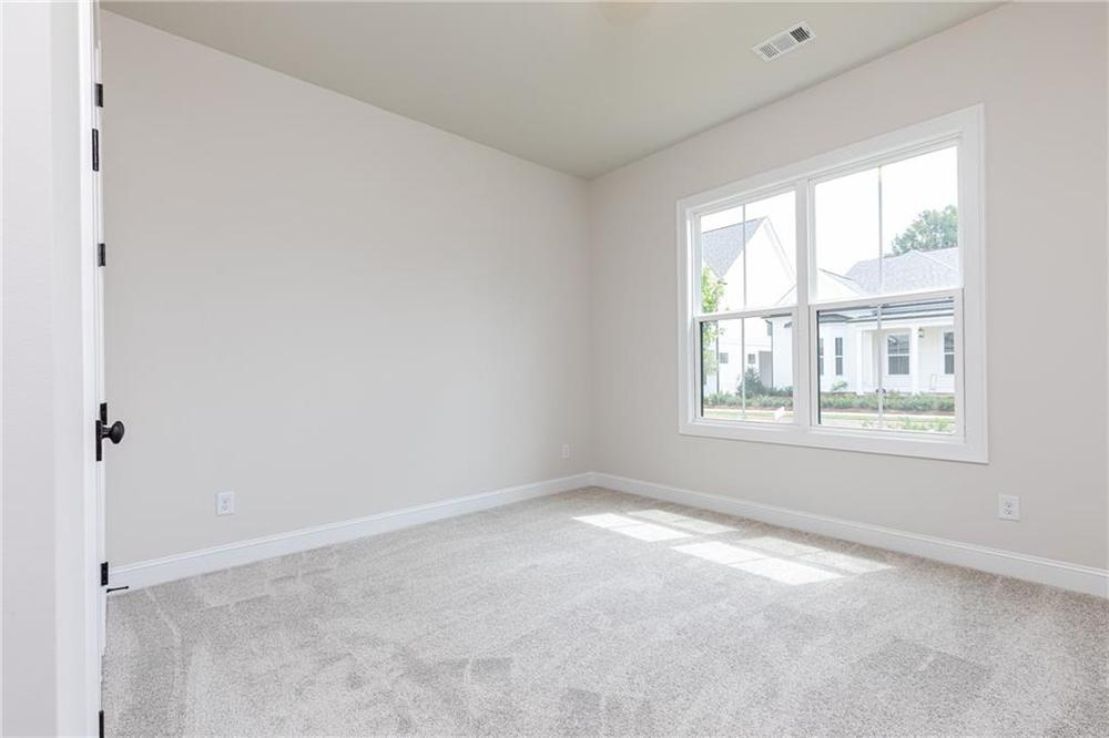 Not actual home. Photo of previously built McDaniel. New Home in Canton, GA
